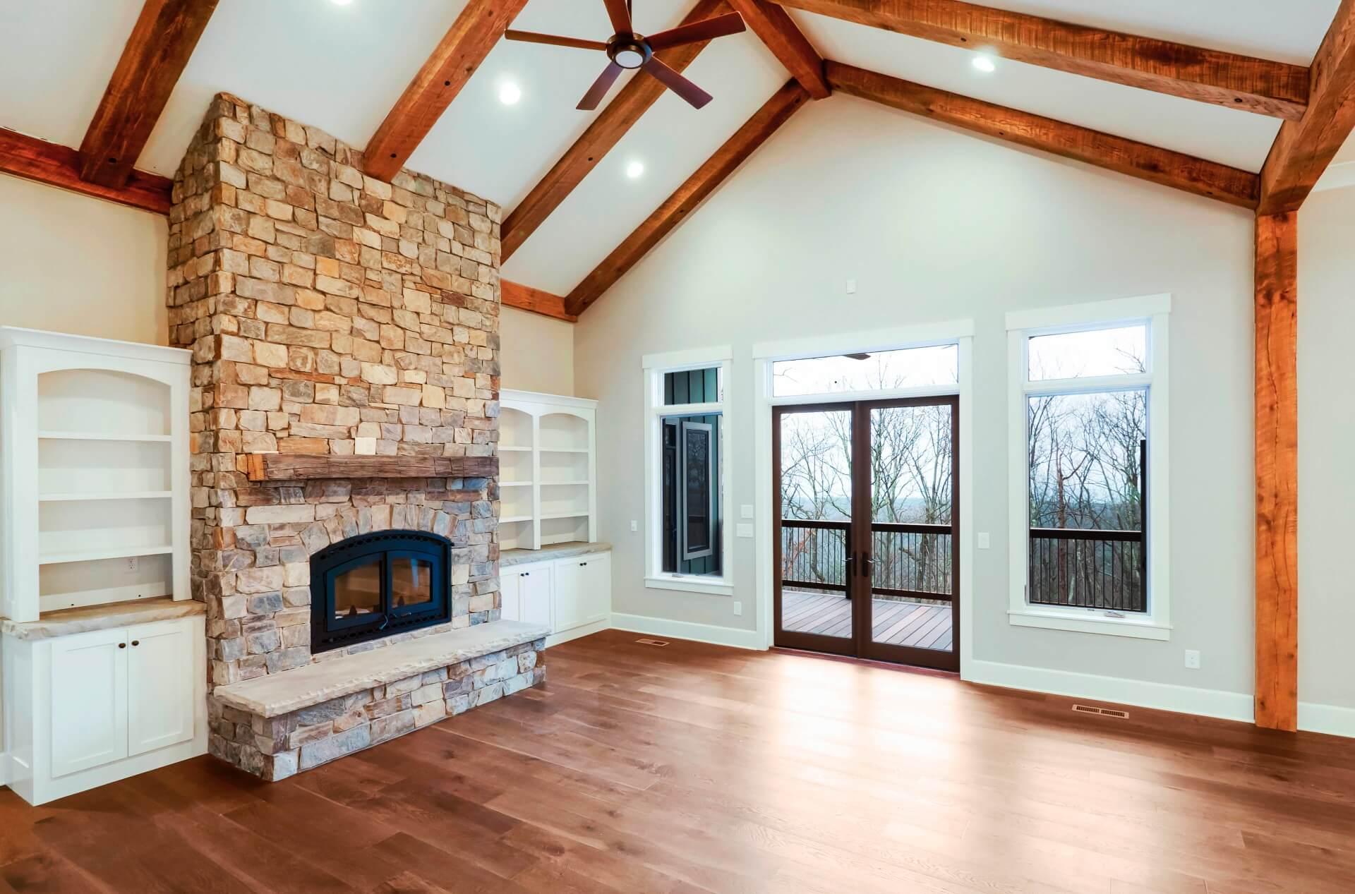 living-room-custom-oak-beams-exposed-rustic-granite-fireplace-1